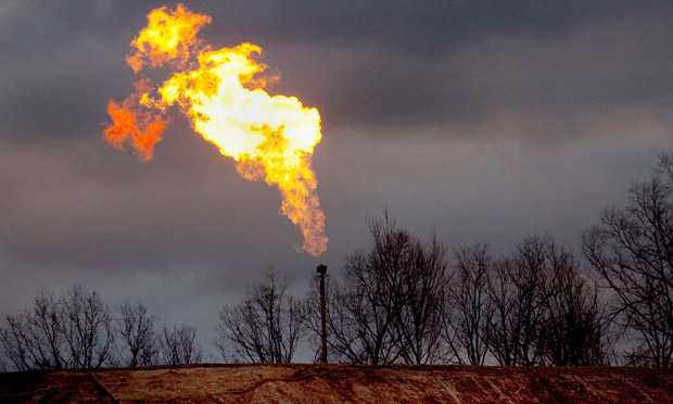 Gas flare burns at a fracking site. Image courtesy The Guardian