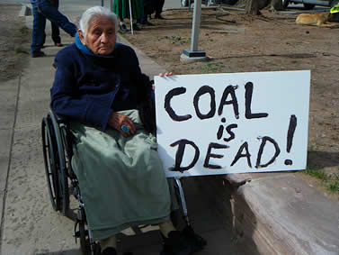 Worldwide, coal is dead. A Navajo Nation woman protesting for change. Image by Wahleah Johns.